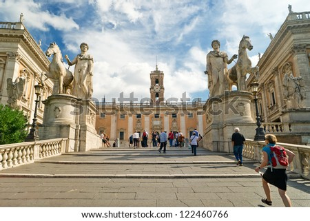 ROME - OCTOBER 3: Tourists climb the stairs to Capitoline on October 3, 2012 in Rome, Italy. Capitol Hill - one of the hills of ancient Rome, where in ancient times was the Senate. - stock photo