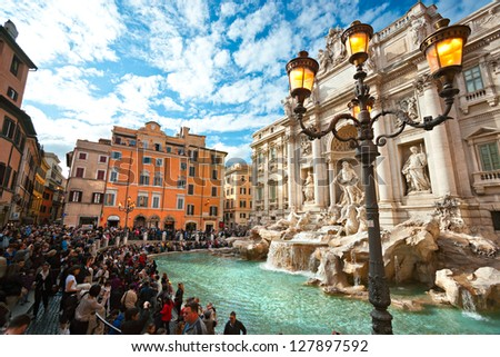 ROME - OCTOBER 21: Tourists visiting the Trevi Fountain on October 21, 2011 in Rome. Trevi Fountain is among the most iconic fountains in the world and one of Italy's top tourism destinations. - stock photo