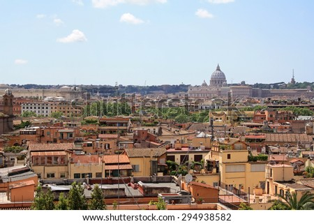 Rome roofs view with Vatican Cathedral in the background - stock photo