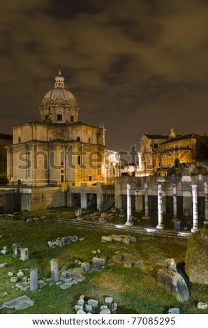 Rome - Santi Luca e Martina church and Roman Forum at night - stock photo