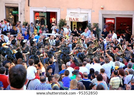 ROME - SEPTEMBER 18: Crowd in Piazza di Spagna on September 18, 2011 in Rome. Piazza di Spagna with its fountain and Spanish Steps is among most iconic squares worldwide. - stock photo