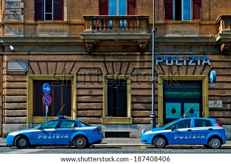 ROME - SEPTEMBER 21: Italian Police vehicles outside Piazza Cavour Station on September 21, 2013 in Rome, Italy. Italian Police is known for using only Italian made vehicles, Alfa Romeo and Fiat. - stock photo