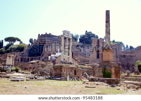 ROME - SEPTEMBER 17: The Roman Forum area on September 17, 2011 in Rome. The Roman Forum is a rectangular forum surrounded by the ruins of important ancient government buildings at the center of Rome. - stock photo
