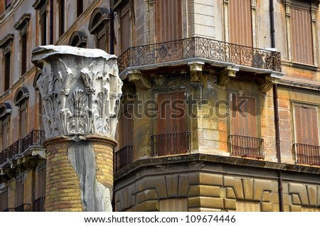 Rome street scene with a head of a column