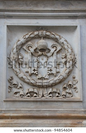 Rome, The coat of arms at Vatican City - stock photo