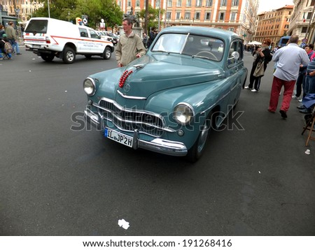 ROME, VATICAN - April 27, 2014: Over a 60 year old car FSO Warszawa M-20, which was owned by Cardinal Karol Wojty?a, later Pope John Paul II, during the canonization in Rome on 27 April 2014. - stock photo