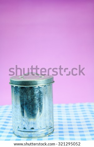 ron Bin on pink background. - stock photo