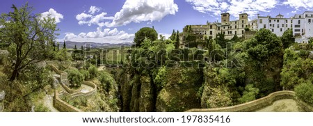 Ronda panoramic view. A Spanish city in Andalusia. Situated in a mountainous area about 750 m above mean sea level. The Guadalevín River runs through the city, dividing it in two and carving the steep - stock photo