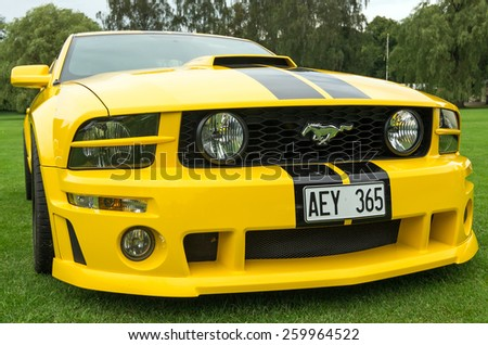 "RONNEBY, SWEDEN - AUGUST 09: Summer V8 car fans event ""Pony & muscle car meet"". Front view of Ford Mustang model 2005 in 08 August, 2014 in Ronneby, Sweden. - stock photo"