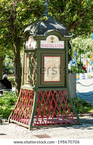 "RONNEBY, SWEDEN - JUNE 14, 2014: Public telephone booth in town square. Old national telephone ""rikstelefon"" replica."