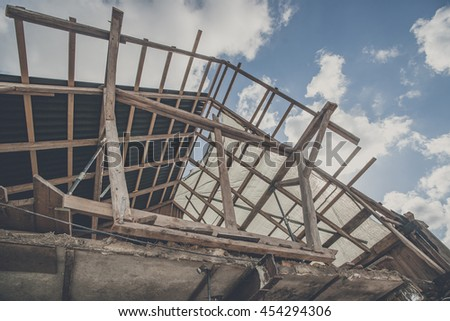 Roof construction with wooden planks in the blye sky
