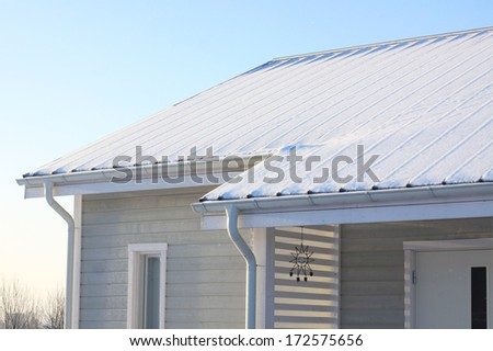 Roof covered in snow - stock photo