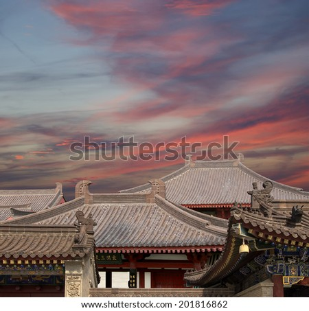 Roof decorations on the territory Giant Wild Goose Pagoda, is a Buddhist pagoda located in southern Xian (Sian, Xi'an), Shaanxi province, China    - stock photo