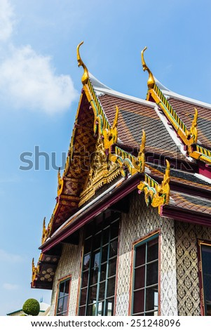 Roof detail in Wat Phra Kaew, Temple of the Emerald Buddha, Bangkok, Thailand. - stock photo