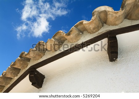 roof from a Spanish villa typical roofing tiles, blue sky)