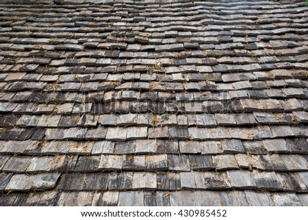 Roof made of wood. Close Up Wooden Tile Background - stock photo