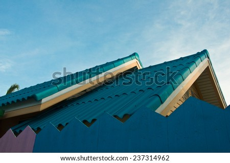 Roof of a new blue wooden house with a blue sky - stock photo