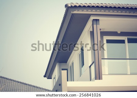 Roof of house and blue - stock photo