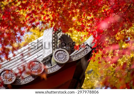 roof of japanese temple around of colorful of maple ang ginko leaves at autumn season in daigoji temple , kyoto - stock photo