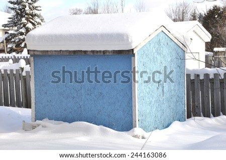 Roof of wooden shed full of snow - stock photo