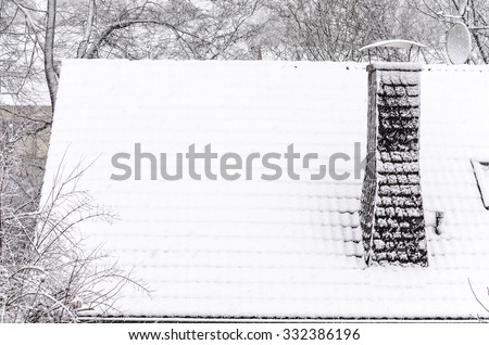 Roof snowed in new snow in the morning. - stock photo