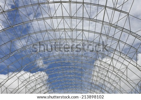 Roof structure of raw material warehouse, Cement factory.  - stock photo
