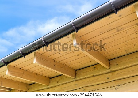 Roof structure with wooden rafters in traditional style - stock photo