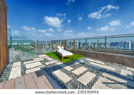 Roof terrace with jacuzzi and sun lounger during day - stock photo