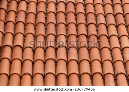Roof tiles background texture in regular rows. - stock photo