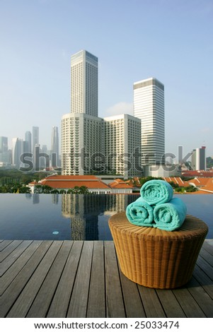 Roof top infinity pool and business district skyline, Singapore - stock photo