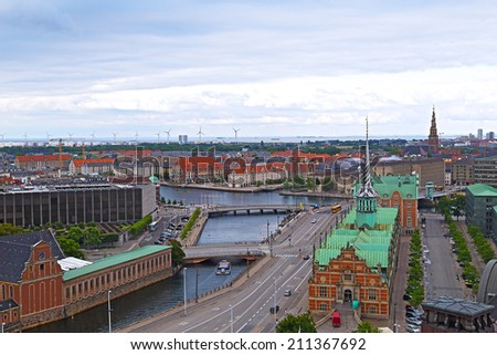 Roof tops of Copenhagen, Denmark. Panorama of colorful roof tops and old churches in Copenhagen, Denmark. - stock photo
