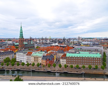 Roof tops of Copenhagen, Denmark. Panorama of colorful roof tops and old churches in Copenhagen, Denmark - stock photo