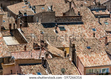 Roof tops with TV antennas and roofing tiles.