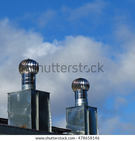 Roof valves against the blue bright sky
