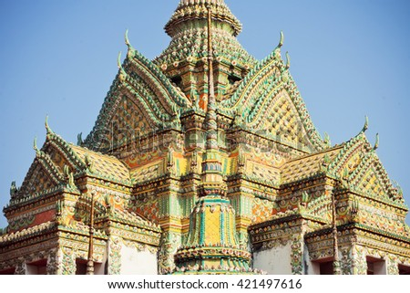 Roof with a mosaic of colored stones in Buddhist monastery Wat Pho, founded in 16th century, Bangkok, Thailand - stock photo