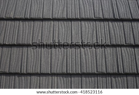 Roof with black bitumen shingles pattern abstract - stock photo