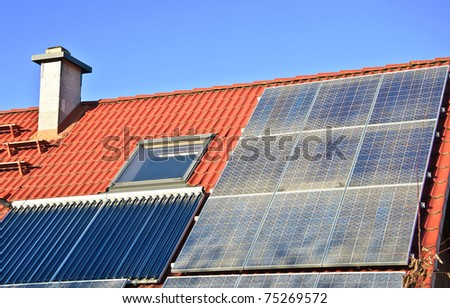 Roof with solar panels. - stock photo