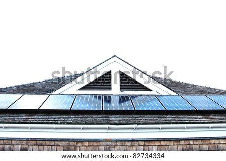 Roof with solar panels fragment - stock photo