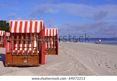 roofed wicker beach chairs at the beach - stock photo