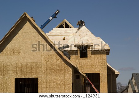 roofing the new house - stock photo