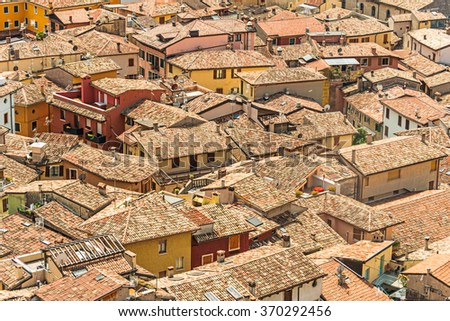 Roofs of a Mediterranean town in bright sunlight - stock photo