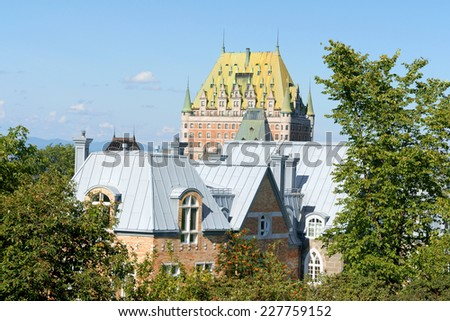 Roofs of some old buildings and Chateau Frontenac Hotel in downtown Quebec City, Canada - stock photo