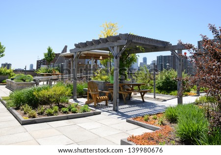 Rooftop garden in urban setting - stock photo