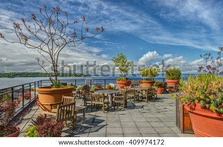 Rooftop Patio Sports Beautiful Views of Puget Sound on Lovely Spring Day - stock photo