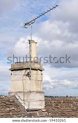 Rooftop View of Chimney and TV Aerial - stock photo