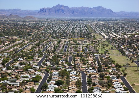 Rooftops against the backdrop of the Superstition Mountains - stock photo