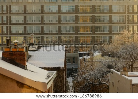 Rooftops and Chimneys in a light snow in center city philadelphia - stock photo