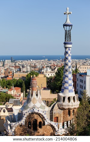 Rooftops and spires of porter's lodge pavilions by Antoni Gaudi in Park Guell, Barcelona, Catalonia, Spain. - stock photo