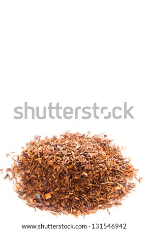 Rooibos tea close up isolated on white background. - stock photo
