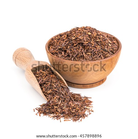 Rooibos tea in a wooden bowl isolated on white - stock photo